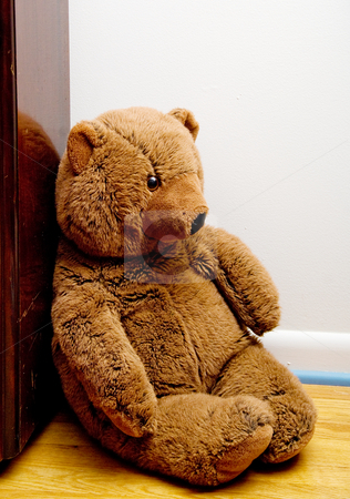 Teddy Bear stock photo, A teddy bear sitting in a corner. by Robert Byron