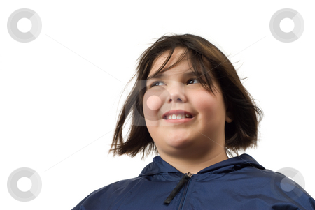Isolated Girl stock photo, Low angle view of a young girl glancing around by Richard Nelson