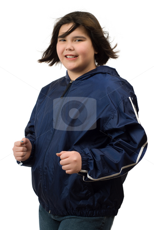 Child Jogging stock photo, A young girl jogging, isolated against a white background by Richard Nelson