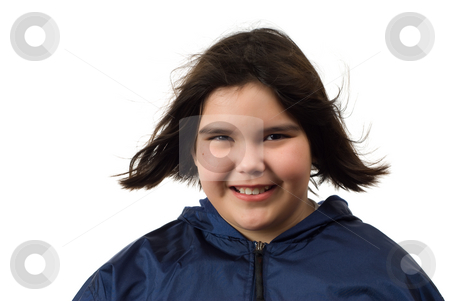 Blowing Hair stock photo, Front view of a young girl wearing a light jacket and the wind blowing her hair around by Richard Nelson