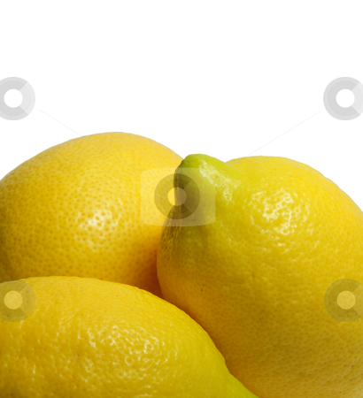 Yellow Lemon stock photo, Multiple lemons on a light colored background by Lynn Bendickson