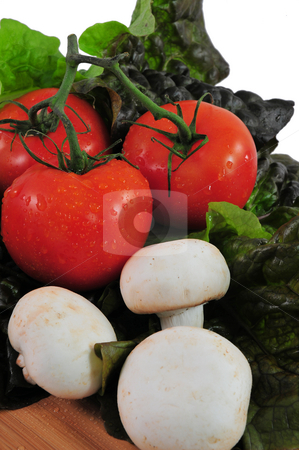 Vegetables And Mushrooms stock photo, Tomatoes and assorted vegetables on a cutting board by Lynn Bendickson