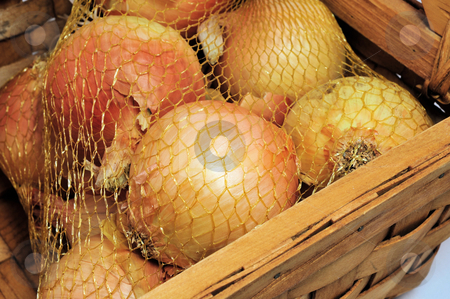 Yellow Onions stock photo, Onions in a mesh bag and wooden basket. by Lynn Bendickson