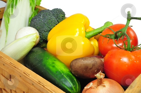 Vegtables In A basket stock photo, Assorted vegtables in a wooden basket on a light background by Lynn Bendickson