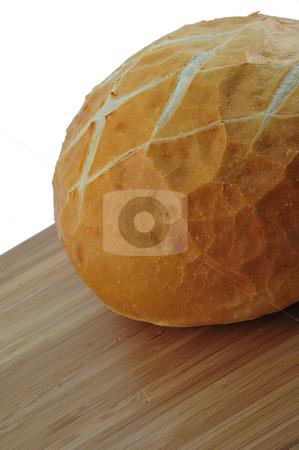 Fresh Sourdough stock photo, Round loaf of fresh sourdough bread on a cutting board by Lynn Bendickson