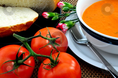 Tomato Soup stock photo, Hot Tomato soup in a bowl with bread on the side by Lynn Bendickson