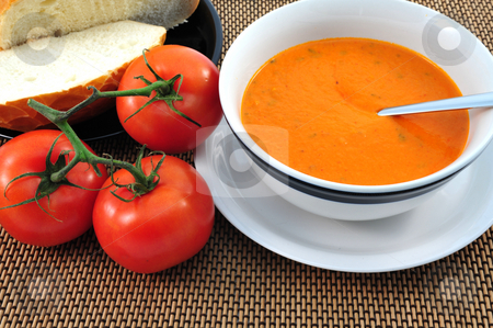 Tomato Soup And Tomatoes stock photo, Hot Tomato soup in a bowl with bread on the side by Lynn Bendickson