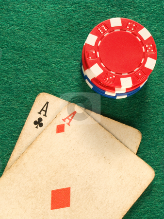 Two old poker card aces and colorful poker chips. stock photo, Two old poker card aces and colorful poker chips. by Stephen Rees