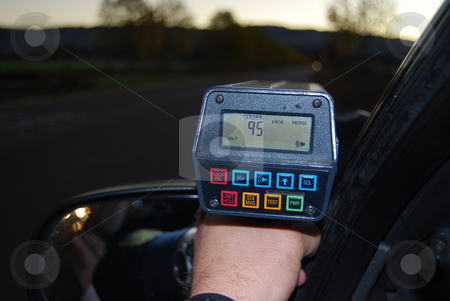 Speed Enforcement stock photo, Officer conducting traffic enforcement for speeding vehicles. by Steven Kapinos