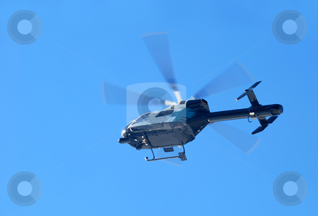 Mountain Rescue Helicopter stock photo, Mountain rescue helicopter flying shown against blue sky by Denis Radovanovic