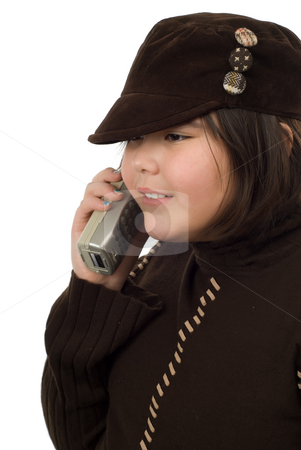 Girl Talking On The Phone stock photo, A young girl taking on a portable phone, isolated against a white background by Richard Nelson