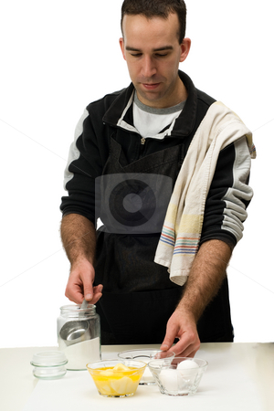 Home Chef stock photo, A young man mixing baking ingredients together, isolated against a white background by Richard Nelson