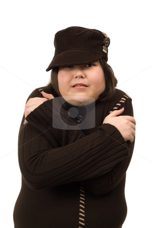 Shivering Child stock photo, A young girl shivering, isolated against a white background by Richard Nelson
