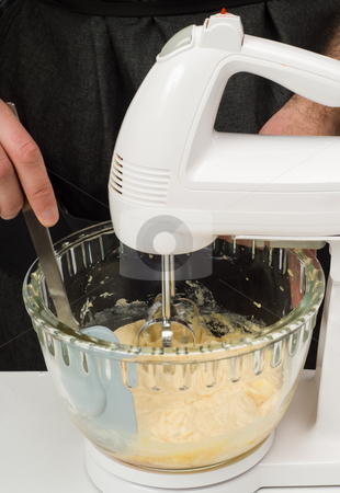 Electric Beater stock photo, An electric beater mixing up some ingredients for cookies by Richard Nelson