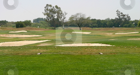 Golf stock photo, Golf driving range or green fairway with bunkers by Henrik Lehnerer
