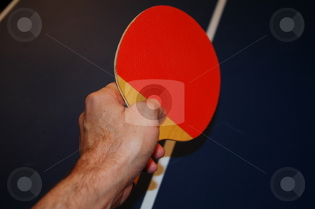 Ping pong  stock photo, Ping pong game, a hand ready to strike the ball by Tim Markley