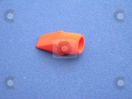 Eraser stock photo, A red eraser top on a blue background by Tim Markley