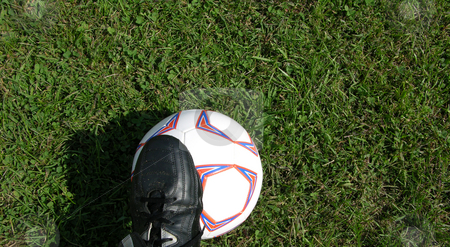 Foot on ball stock photo, Foot on a soccer ball by Tim Markley