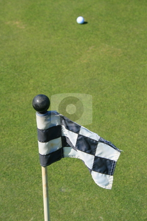 Golf Course Flag And A Golf Ball stock photo,  by Michael Felix