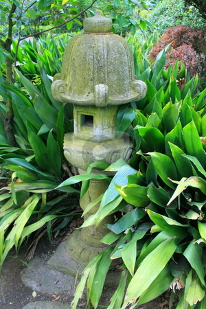 Japanese Statue in a Garden stock photo,  by Michael Felix