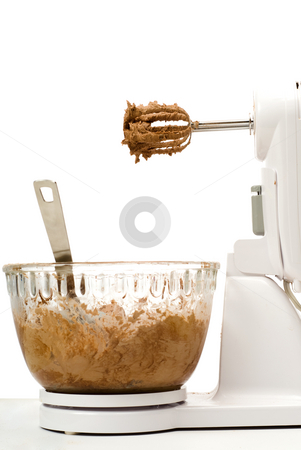 Electric Beater With Bowl stock photo, An electric beater with chocolate batter, isolated against a white background by Richard Nelson