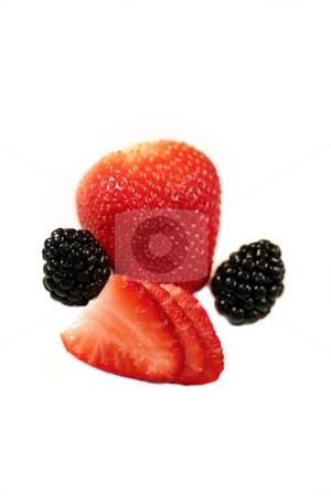 Strawberry Blackberry stock photo, Red strawberry with two black blackberries and some slices. by Henrik Lehnerer