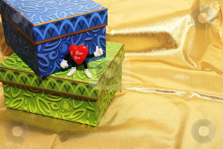 Boxes stock photo, Display of boxes with a heart Valentine  figurine by Jack Schiffer
