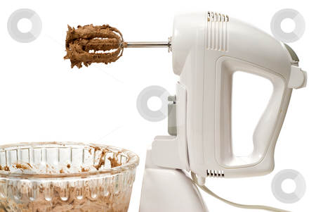 Electric Beater stock photo, An electric beater with chocolate cookie batter , isolated against a white background by Richard Nelson