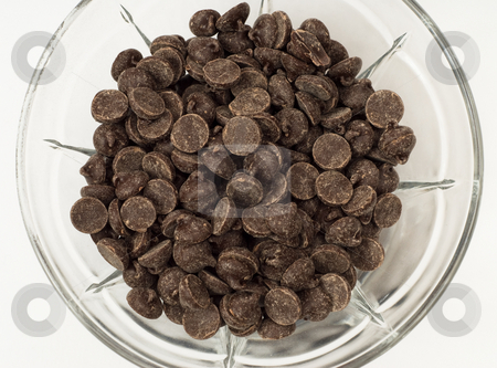 Chocolate Chips stock photo, A glass bowl of chocolate chips, shot on white by Richard Nelson