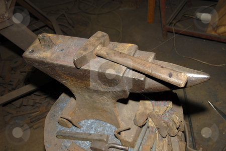 Hammer and anvil stock photo, Hammer and anvil in an old smithy by Joanna Szycik