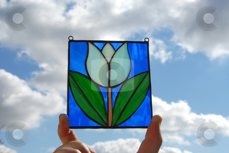 Stained glass vitrage stock photo, Stained glass vitrage with colourful glass in my hand on the background of sky by Joanna Szycik