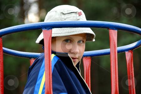 Boy on the playground stock photo, Boy on the playground. Summer time. by Joanna Szycik