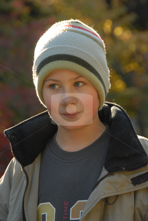 Portret of boy stock photo, Outdoor portret of smiling young boy in sunlight by Joanna Szycik
