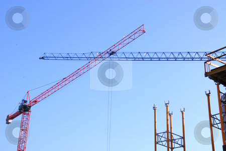 Two cranes stock photo, Two build steel cranes over blue sky by Joanna Szycik