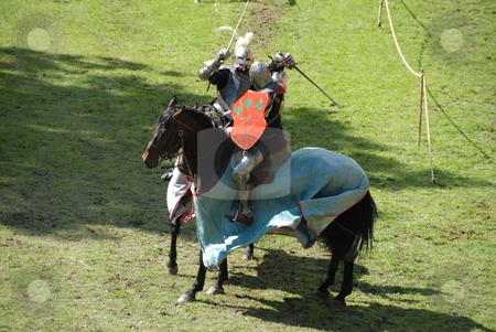 Knights on horses stock photo, The Siege of Malbork- reconstruction of events from the year 1410 - medieval castle, knights on horses by Joanna Szycik
