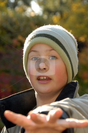 Portret of boy stock photo, Outdoor portret of smiling young boy in sunlight. by Joanna Szycik