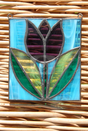Stained glass vitrage stock photo, Stained glass vitrage with colourful glass in my hand on the background of wicker by Joanna Szycik