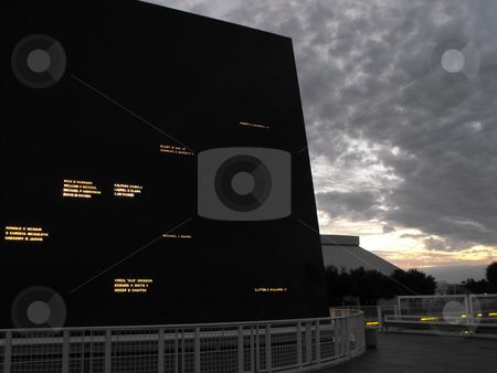 Astronaut Monument stock photo, The names of the 17 U.S. astronauts who gave their lives for space exploration are carved into the face of this polished black granite monument in their honor (night view).  Located at NASA's Kennedy Space Center Visitor Complex, the 60 ton structure tracks the movement of the sun through the sky. by Dennis Thomsen