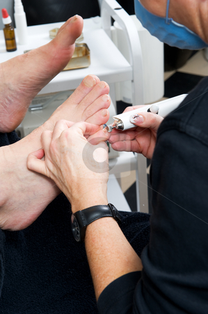 Foot therapist at work stock photo, Foot therapist working om adult male feet, fixing the nails and skin. by Flemming Jacobsen
