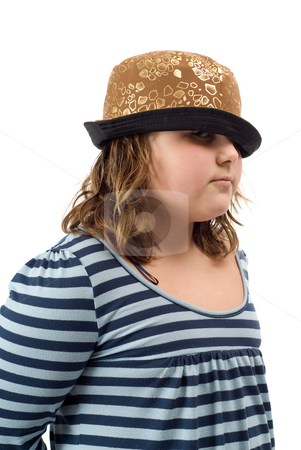 Girl Wearing A Hat stock photo, A young girl wearing a funky hat, isolated against a white background by Richard Nelson