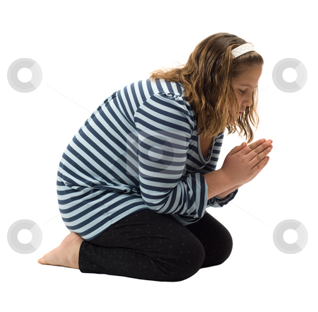 Prayer stock photo, A young girl saying her bedtime prayer, isolated against a white background by Richard Nelson