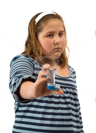Asthma stock photo, A young girl showing off her inhaler for asthma, isolated against a white background by Richard Nelson