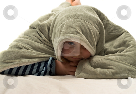 Hide and Seek stock photo, A young girl playing hide and seek under a soft blanket by Richard Nelson
