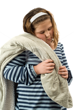 Tired Child stock photo, A young girl looking tired and carrying her blanket, isolated against a white background by Richard Nelson