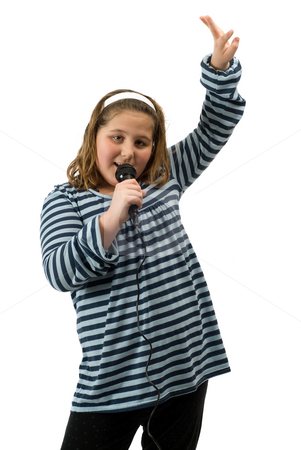 Karaoke stock photo, A young girl singing karaoke and having a fun time, isolated against a white background by Richard Nelson