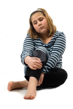 Depressed Child stock photo, A young girl sitting on the floor feeling sad, isolated against a white background by Richard Nelson