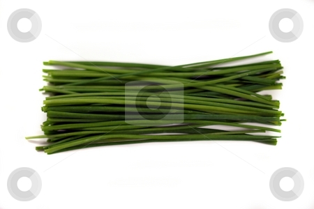 Chives stock photo, Bundle of fresh green chives on white background. by Henrik Lehnerer