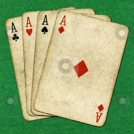 Four old vintage dirty aces poker cards on a green cloth. stock photo, Four old vintage dirty aces poker cards on a green cloth. by Stephen Rees