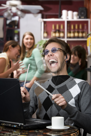 Obnoxious young man singing loudly stock photo, Obnoxious young man singing loudly in a coffee house by Scott Griessel