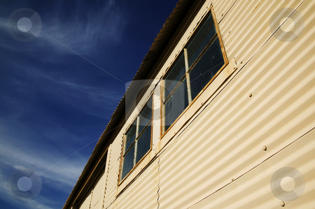 Windows on a Mteal Building stock photo, Windows on an old currugated metal building. by Scott Griessel